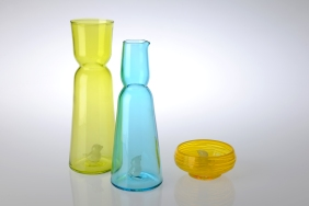 Glass. Vase: 32cm x 11 cm. Jug: 29 cm x 10 cm. Small Bowl: 6 cm x 14 cm. Available in Blue, Lime, and Saffron.