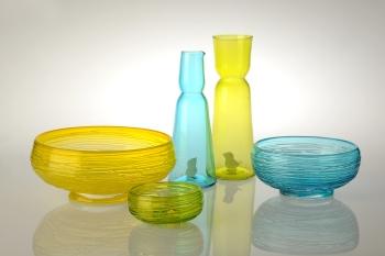 Glass. Large Bowl: 30 cm x 11 cm. Medium Bowl: 23.5 cm x 9 cm. Vase: 32cm x 11 cm. Jug: 29 cm x 10 cm. Small Bowl: 6 cm x 14 cm. Available in Blue, Lime, and Saffron.