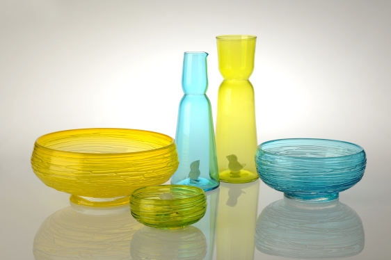 Glass. Large Bowl: 30 cm x 11 cm. Medium Bowl: 23.5 cm x 9 cm. Vase: 32cm x 11 cm. Jug: 29 cm x 10 cm. Small Bowl: 6 cm x 14 cm. Available in Blue, Lime, and Saffron.