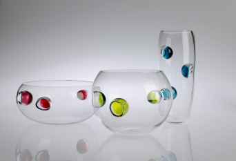 From left to right: Squat Bowl, Medium Bowl, and Vase. Available in Ruby, Lime Green, Teal Blue and Deep Purple.